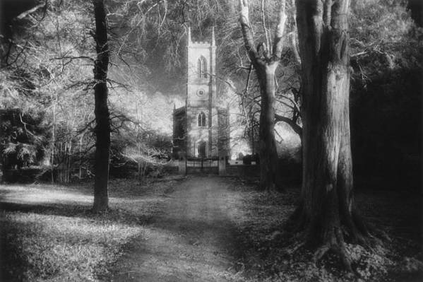 Eerie; Atmospheric; Spooky; Country Lane; Track; Approach; Wooded; Facade; Clock Tower; Exterior; Architecture; English; Spooky; Haunting; Haunted; Mysterious; Dramatic; Gothic Art Print featuring the photograph Church Of St Mary Magdalene by Simon Marsden