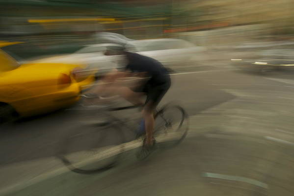 Taxi Blur Art Print featuring the photograph Dodging The Taxi by William Carson Jr