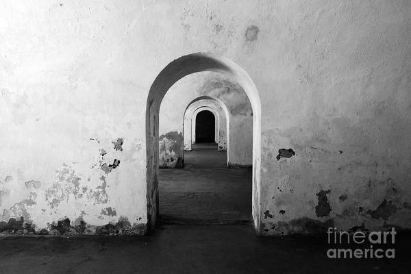 Travelpixpro Puerto Rico Art Print featuring the photograph El Morro Fort Barracks Arched Doorways San Juan Puerto Rico Prints Black And White by Shawn O'Brien