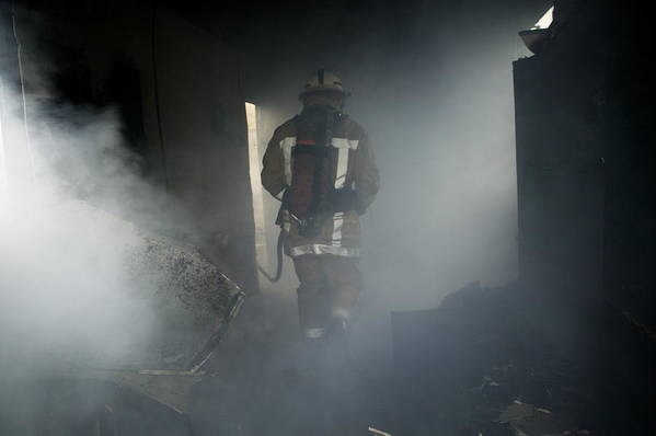 Emergency Service Art Print featuring the photograph Fire Fighter In A Burnt House by Michael Donne