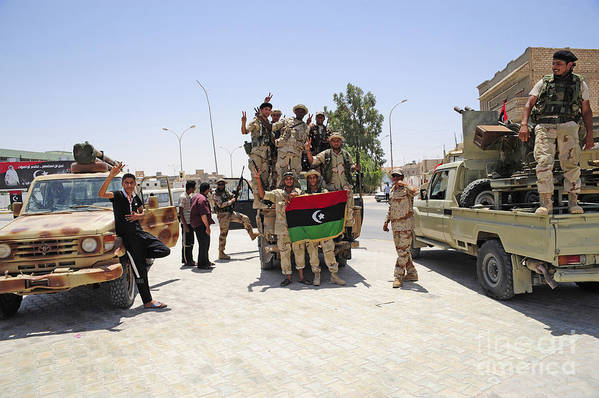 Ajadabiya Print featuring the photograph Free Libyan Army Troops Pose by Andrew Chittock