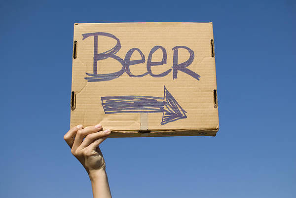 18-19 Years Art Print featuring the photograph Hand Holding Up Makeshift 'beer' Sign by Pete Starman