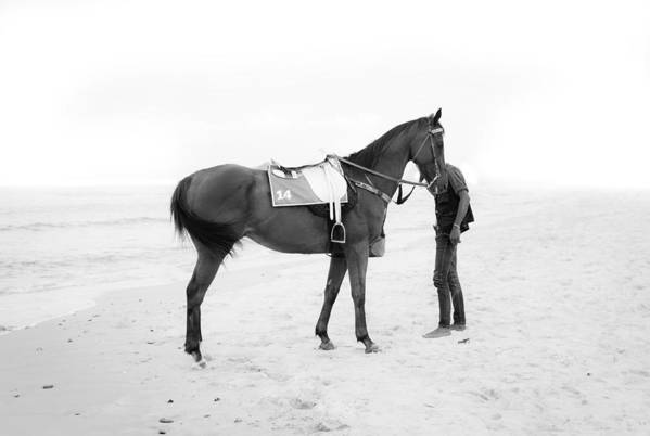 Boy Art Print featuring the photograph Horse And Man On The Beach Black And White by Kittipan Boonsopit