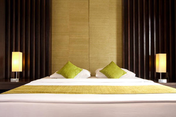 Hotel Art Print featuring the photograph King Size Bed by Atiketta Sangasaeng