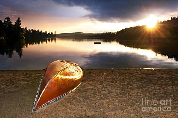 Canoe Art Print featuring the photograph Lake Sunset With Canoe On Beach by Elena Elisseeva