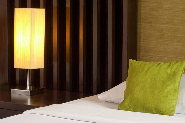 Hotel Art Print featuring the photograph Lamp And Bed by Atiketta Sangasaeng