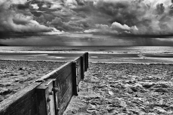 Groyne Art Print featuring the photograph Out To Sea Monochrome by Steve Purnell