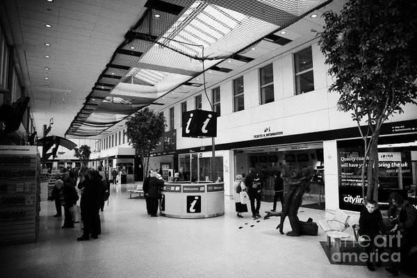 Glasgow Art Print featuring the photograph passenger concourse of Glasgow Buchanan street bus station Scotland UK by Joe Fox