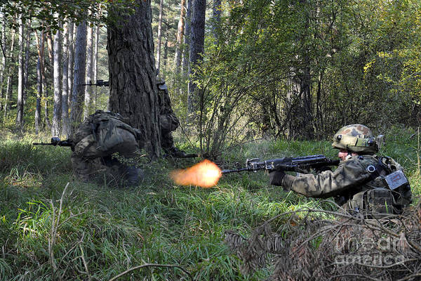 Shooting Art Print featuring the photograph Polish Soldiers Engage In Simulated by Stocktrek Images