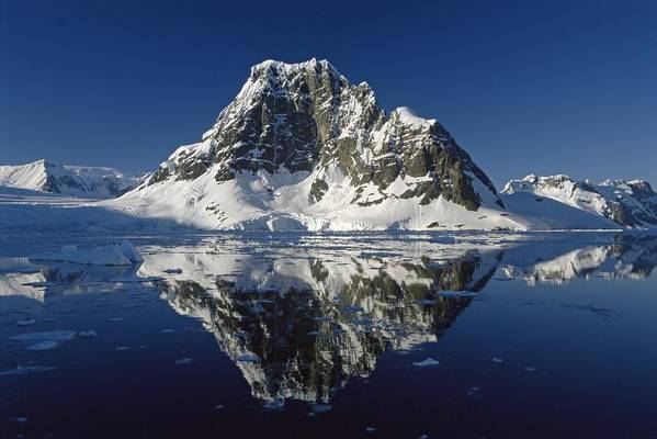 Landscape; Seascape; Reflection; Rocky; Rocks; Rock; Coast; Coastal; Shore; Ice; Icy; Mountain; Mountainous; Dramatic; Picturesque; Cliff; Cliffs; Glacier; Still; Calm; Scenic; View; Blue Sky; Reflected; Peak; Remote; South Pole Art Print featuring the photograph Reflections With Ice by Antarctica