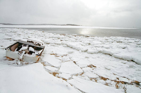Small Boat Art Print featuring the photograph Small Boat Sits On Ice Chuncks In Wellfleet On Cape Cod In Winte by Matt Suess