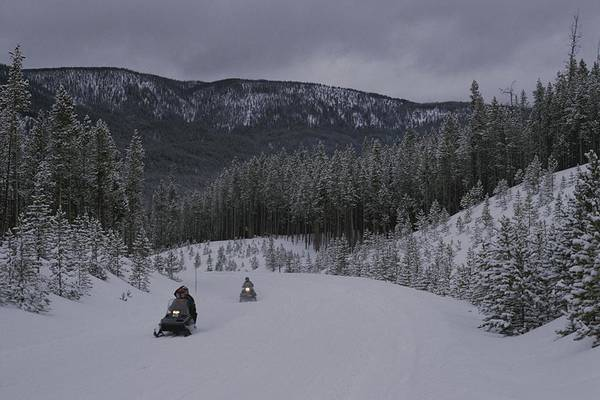 North America Art Print featuring the photograph Snowmobilers In Yellowstone National by Raymond Gehman