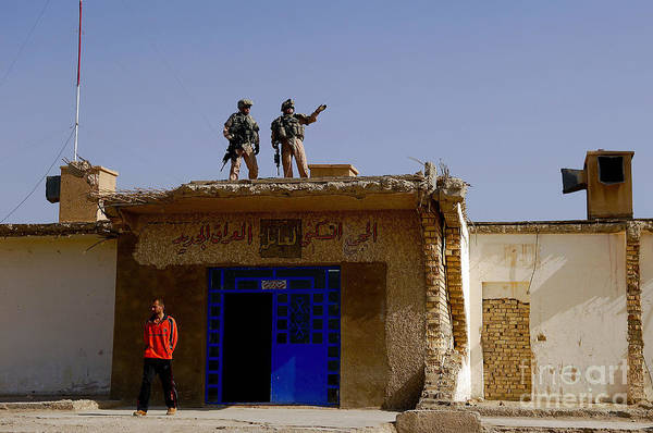 Atop Art Print featuring the photograph Soldiers Discuss The New Iraqi Police by Stocktrek Images
