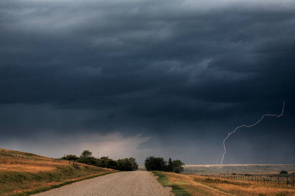 Roadside Art Print featuring the digital art Storm Clouds And Lightning Along A Saskatchewan Country Road by Mark Duffy