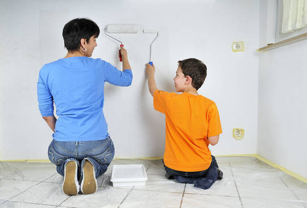 Boy Print featuring the photograph Teamwork - Mother And Son Painting Wall by Matthias Hauser