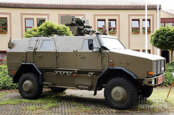 Armament Art Print featuring the photograph The Multi-purpose Protected Vehicle by Luc De Jaeger