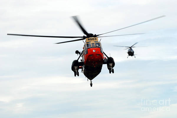 A109 Art Print featuring the photograph The Sea King Helicopter And The Agusta by Luc De Jaeger