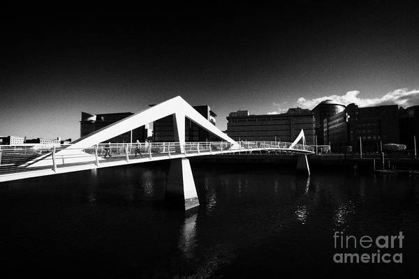 Tradeston Art Print featuring the photograph The Tradeston Bridge Pedestrian Bridge Over The River Clyde To The Financial District Of Glasgow Sco by Joe Fox