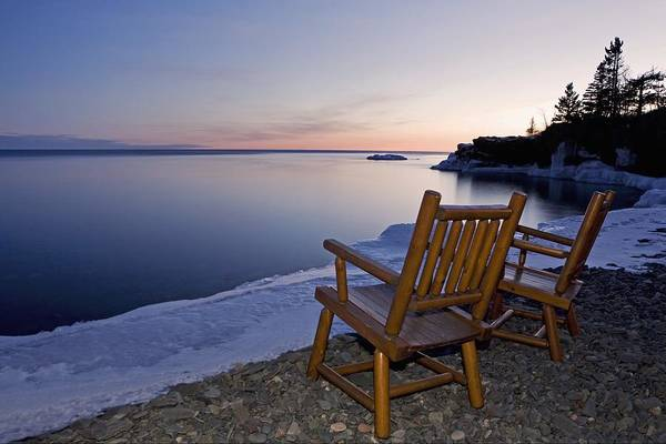 Sunset Art Print featuring the photograph Two Chairs At Waters Edge Looking Out by Susan Dykstra