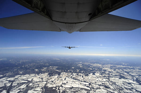 Ec-130 Art Print featuring the photograph Two Ec-130j Commando Solo Aircraft Fly by Stocktrek Images