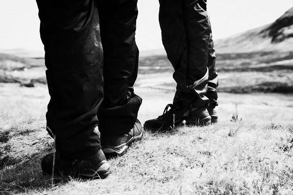 Hiking Art Print featuring the photograph two hikers hillwalkers in the highlands of Scotland UK by Joe Fox