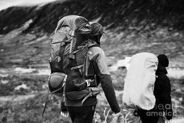 Two Art Print featuring the photograph two male walkers hikers in the highlands of scotland glencoe Scotland UK by Joe Fox