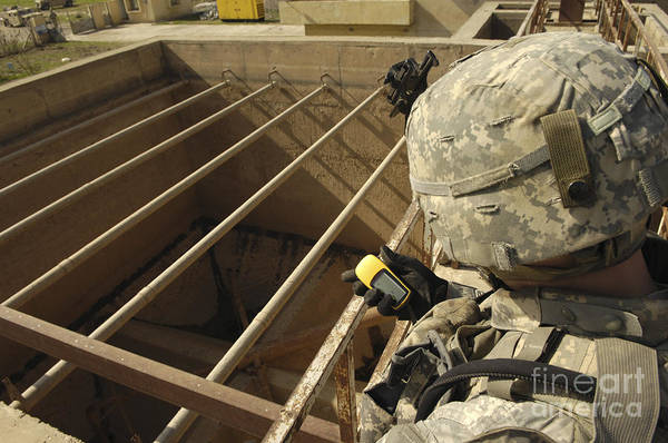 Iraq Art Print featuring the photograph U.s. Army Soldier Takes A Gps Grid by Stocktrek Images
