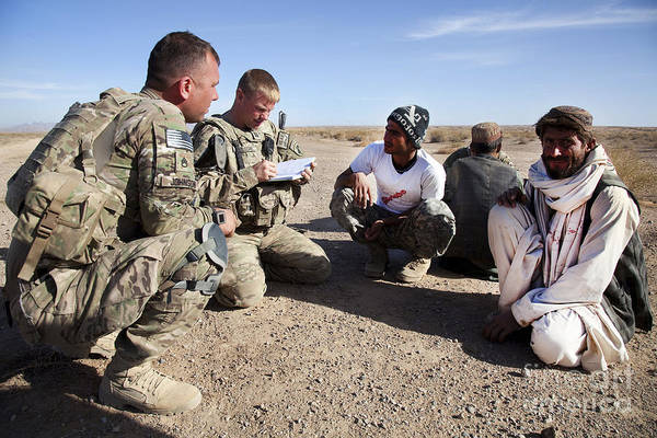 International Security Assistance Force Art Print featuring the photograph U.s. Army Soldiers Speak With Elders by Stocktrek Images