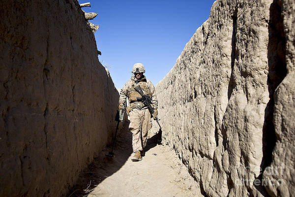 Afghanistan Art Print featuring the photograph U.s. Marine Sweeps An Alleyway by Stocktrek Images