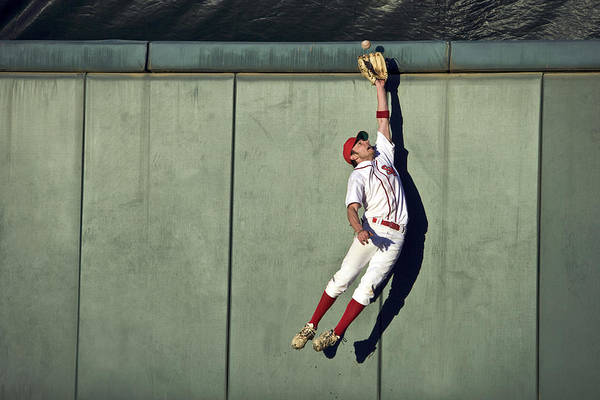 25-29 Years Art Print featuring the photograph Usa, California, San Bernardino, Baseball Player Making Leaping Catch At Wall by Donald Miralle