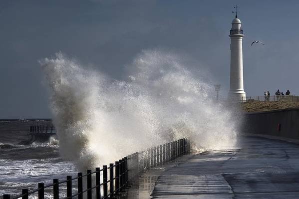 Building Exterior Art Print featuring the photograph Waves Crashing By Lighthouse At by John Short