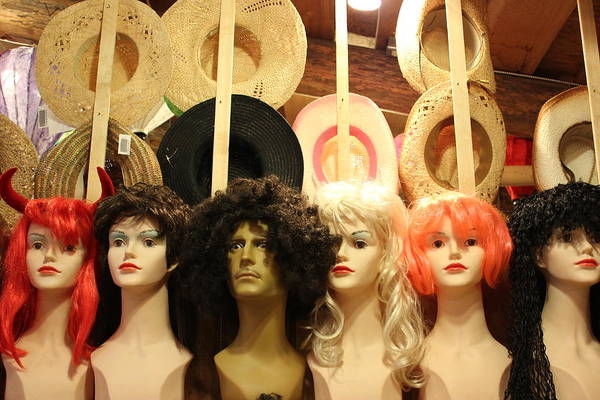 Wigs And Hats At The Coombs Market Art Print featuring the photograph Wigs And Hats by Brian Sereda