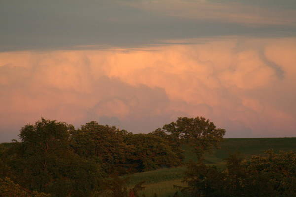 A Very Peaceful Scene Art Print featuring the photograph Clouds Of A Distant Storm by Linda Ostby