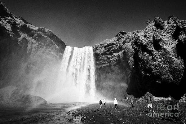 Skogafoss Art Print featuring the photograph Crowds Of Tourists At Skogafoss Waterfall In Iceland by Joe Fox