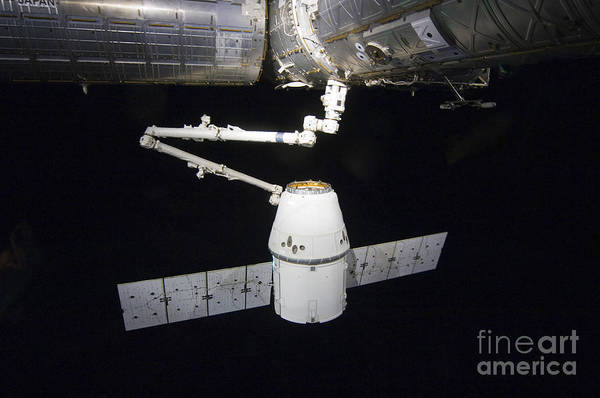 Color Image Art Print featuring the photograph The Spacex Dragon Cargo Craft Prior by Stocktrek Images