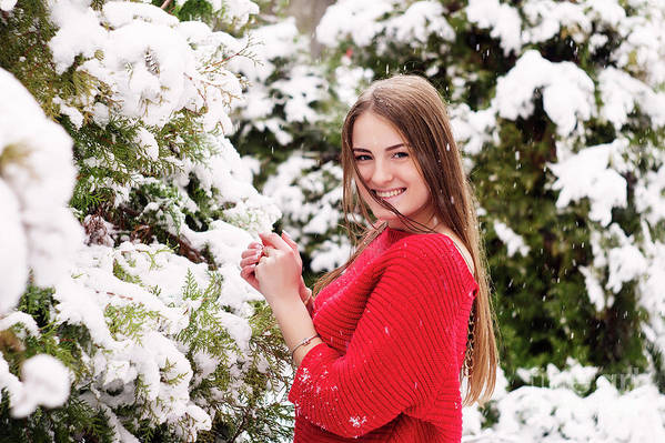 Women Art Print featuring the photograph Beautiful Young Girl Model In Winter In A Parked Park. In A Red Sweater. by Oleksandr Masnyi