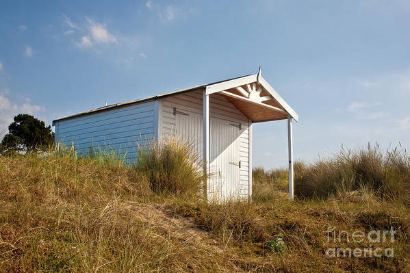 Hut Art Print featuring the photograph A Beach Hut In The Marram Grass At Old Hunstanton North Norfolk by John Edwards