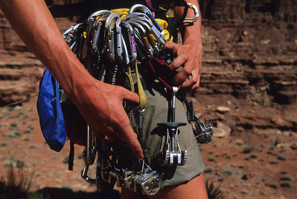 One Person Art Print featuring the photograph A Rock Climber Check Her Gear by Bill Hatcher