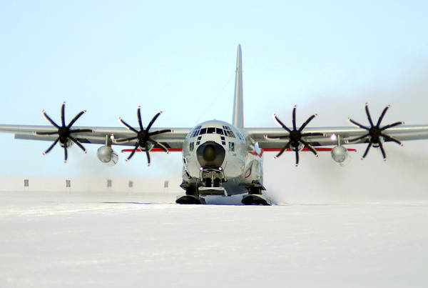 Operation Deep Freeze Art Print featuring the photograph A Ski-equipped Lc-130 Hercules by Stocktrek Images
