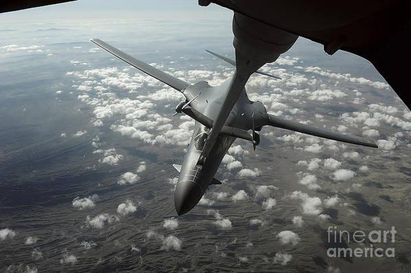 In-flight Art Print featuring the photograph A U.s. Air Force Kc-10 Refuels A B-1b by Stocktrek Images