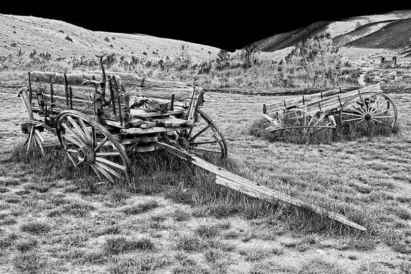 Wagon Art Print featuring the photograph Abandoned Wagons Of Bannack Montana Ghost Town by Daniel Hagerman