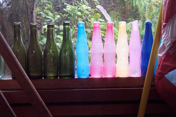 Colored Bottles Art Print featuring the photograph Bottles by Klee Miller