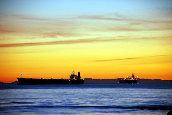 Cargo Art Print featuring the photograph Cargo Ships At Sunset by Alasdair Turner