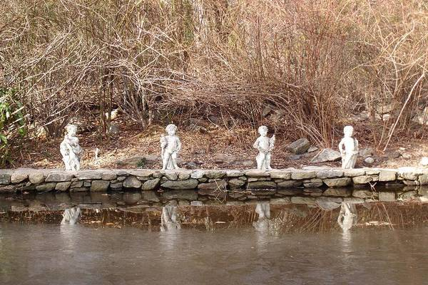 Photograph Art Print featuring the photograph Cerubs On Icy Pond by Susan Grissom