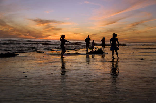Usa Art Print featuring the photograph Children Playing On The Beach At Sunset by James Forte