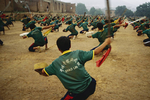 Asia Art Print featuring the photograph Children Practice Kung Fu In A Field by Justin Guariglia