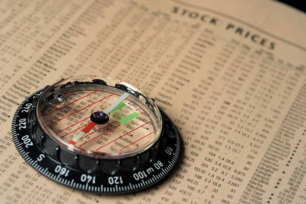 Information Art Print featuring the photograph Compass On Stockmarket Cotation In Newspaper by Sami Sarkis
