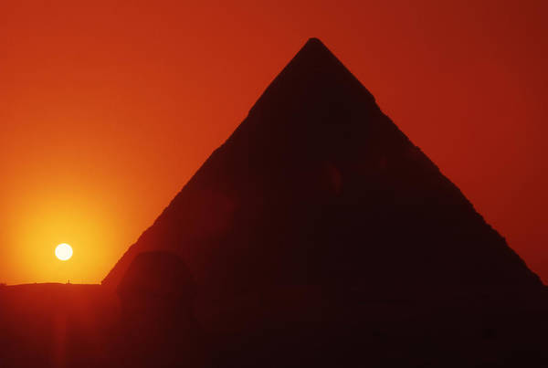 Ancient; Antiquity; Antiquated; Archaeology; Archaelogical; Atmospheric; Egypt Art Print featuring the photograph Egypt. Sunset Behind The Sphinx And Chephren Pyramid. by Steve Outram
