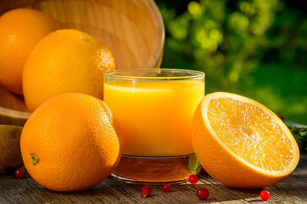 Orange Juice Art Print featuring the photograph Enjoying The Weather by Catalin Tibuleac