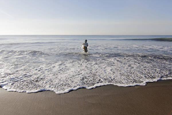 Beach Water Art Print featuring the photograph Fisherman by Gusti putu Suarsana